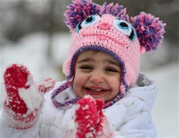 (AP Photo/Observer-Dispatch, Mark DiOrio). Abigail Deep claps her hands to get the snow off her mittens, Monday, Feb. 9, 2015, in Utica, N.Y.