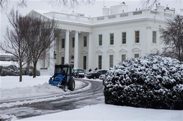 (AP Photo/Evan Vucci). A plow removes snow from the White House driveway after a winter storm, on Tuesday, Feb. 17, 2015, in Washington.