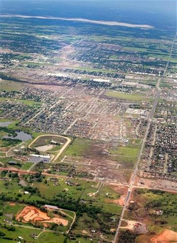 AP Photo/Kim Johnson Flodin, File). File - This May 21, 2013 file aerial photo shows the remains of houses in Moore, Okla., following a May 20, 2013 tornado.