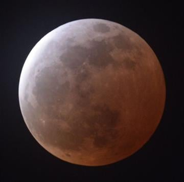 (AP Photo/Kyodo News). A total lunar eclipse is observed in Sendai, Miyagi prefecture, northeastern Japan, Saturday, April 4, 2015. JAPAN OUT, MANDATORY CREDIT