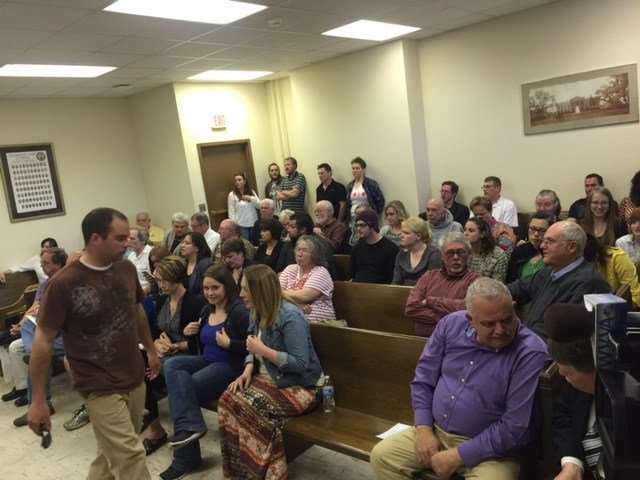Dozens fill county commission meeting in April after dog warden Ronald McClung shot a dog six times, killing the animal.