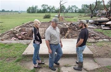 (Travis Heying/The Wichita Eagle via AP). Neighbors of Craig Foraker check out his property after a tornado devastated the area near Bentley, Kan., Wednesday May 6, 2015.