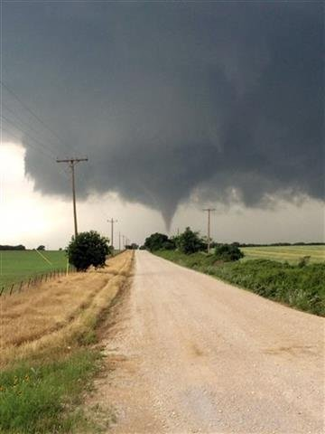 (Brian Khoury via AP). In this Saturday, May 9, 2015 photo provided by Brian Khoury, a tornado touches down in Cisco, Texas.
