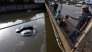(AP Photo/David J. Phillip, File). FILE - In this May 29, 2015 file photo, cars sit in floodwaters along Interstate 45 after heavy overnight rain flooded parts of the highway in Houston.
