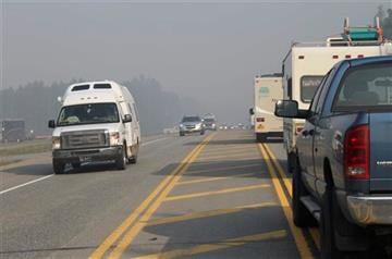 (AP Photo/Mark Thiessen). Southbound traffic, on the left, is allowed to move on the Parks Highway near Willow, Alaska, Monday, June 15, 2015, while northbound drivers wait their turn to be escorted through an active wildfire area.