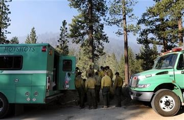 (Micah Escamilla/The Sun via AP). The Crane Valley Hotshots prepare to battle flames near the Heart Bar Campground as the Lake Fire burned during it's sixth day on Monday, June 22, 2015, in the San Bernardino Mountains, Calif.