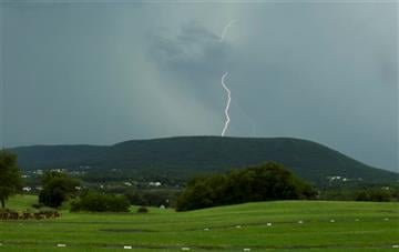 (Nabil K. Mark/Centre Daily Times via AP). Lightning strikes over Mount Nittany in State College, Pa., Tuesday, June 23, 2015, as a thunderstorm moves through Centre County.