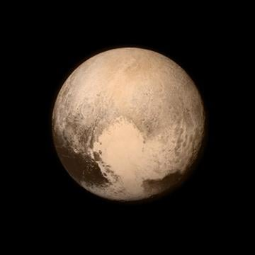 (NASA via AP). This July 13, 2015 image provided by NASA shows Pluto, seen from the New Horizons spacecraft.