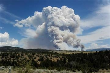 (Thom Bridge/The Independent Record via AP). Smoke rises from a wildfire near Townsend, Mont., Tuesday, July 21, 2015. The fire has closed a portion of U.S. Highway 12 and led to evacuation orders in the rural area.