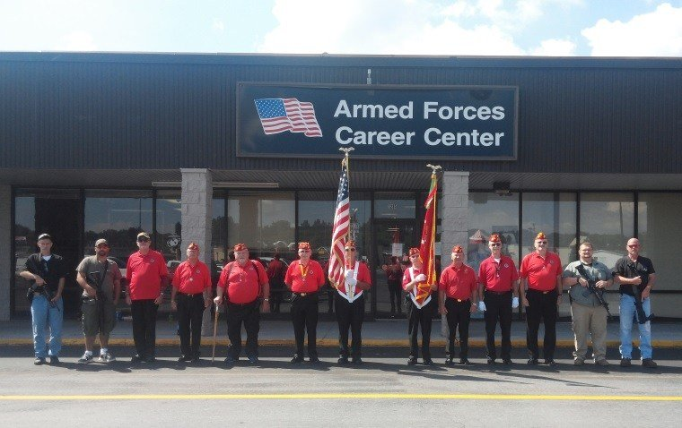 """Members of the Marine Corps League Detachment957 join """"armed citizens"""" outside the Armed Forces Career Center in Princeton on Friday."""
