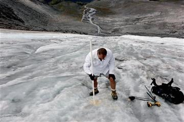 (AP Photo/Manuel Valdes). In this Aug. 7, 2015, photo Oliver Grah, a scientist for the Nooksack Indian Tribe, measures ice melt on the Sholes Glacier in Mount Baker, Wash.