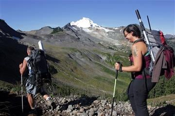 (AP Photo/Manuel Valdes). In this Aug. 7, 2015, photo Oliver Grah and Jezra Beaulieu, scientists hired by the Nooksack Indian Tribe, hike toward Sholes Glacier in the Mount Baker Wilderness, Wash.