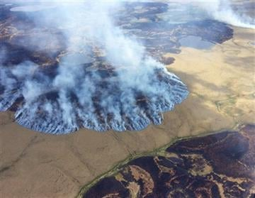 (Matt Snyder/Alaska Division of Forestry via AP, File ). FILE - In this Sunday, June 7, 2015 file photo provided by the Alaska Division of Forestry, smoke rises from the Bogus Creek Fire, one of two fires burning in the Yukon Delta National Wildlife Re...