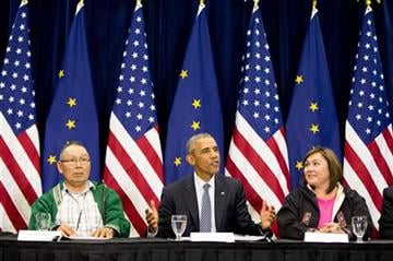(AP Photo/Andrew Harnik). President Barack Obama, center, accompanied by President of the Association of Village Council Presidents Myron Naneng, left, and Kawerak, Inc. President and CEO Melanie Bahnke, right, participates in a roundtable at the Dena'...