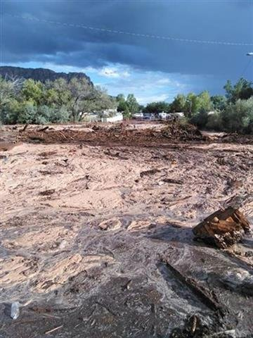 (Mark Lamont via AP). Debris and water cover the ground after a flash flood Monday, Sept. 14, 2015, in Hildale, Utah. Authorities say multiple people are dead and others missing after a flash flood ripped through the town on the Utah-Arizona border Mon...