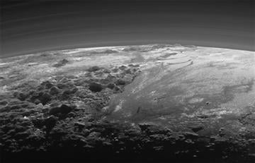 (NASA/JHUAPL/SwRI via AP). This July 14, 2015 photo released by NASA on Thursday, Sept. 17, 2015 shows the atmosphere and surface features of Pluto, lit from behind by the sun. It was made 15 minutes after the New Horizons' spacecraft's closest approach.