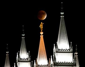 (Lennie Mahler/The Salt Lake Tribune via AP). Earth's shadow obscures the view of a so-called supermoon during a lunar eclipse over the LDS Temple in Salt Lake City, Utah, Sunday, Sept. 27, 2015.