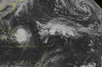 (Weather Underground via AP). This NOAA satellite image taken Wednesday, Sept. 30, 2015, at 9:45 AM EDT shows Hurricane Joaquin just east of the Bahamas.