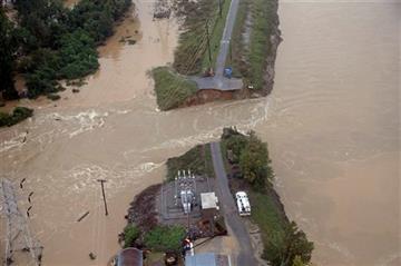 (AP Photo/Chuck Burton). Floodwaters break through a walkway in Columbia, S.C., Monday, Oct. 5, 2015.