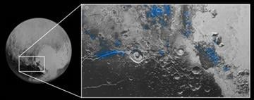 (NASA/JHUAPL/SwRI via AP). This image released by NASA on Thursday, Oct. 8, 2015, shows regions with exposed water ice highlighted in blue in this composite image taken with the New Horizons spacecraft's Ralph instrument.