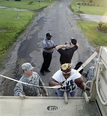 (MYRTLE BEACH HERALD OUT, HORRY INDEPENDENT OUT, CAROLINA FOREST CHRONICLE, GEORGETOWN TIMES OUT). Josephine Winns climbs aboard a vehicle from the South Carolina National Guard as she takes part in a voluntary evacuation from the Oatland and Dunbar, S...