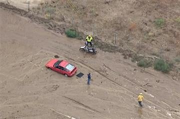 (KABC-TV via AP). This still frame from video provided by KABC-TV shows vehicles stuck in a muddy road in the mountainous community of Lake Hughes, Calif., about 65 miles north of downtown Los Angeles on Thursday, Oct. 15, 2015.