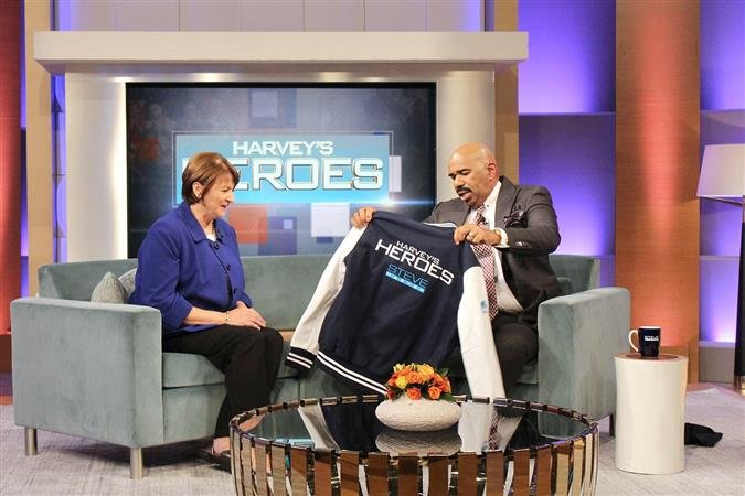 "Twila Smith, a teacher at Philip Barbour High School, is recognized as a ""Harvey's Hero"" on the Steve Harvey Show for her efforts in bringing an end to a hostage situation involving a 14-year-old student peacefully. Photo credit: Deyanna McElroy/ NBC"