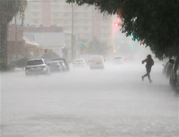 (Victor Calzada/The El Paso Times via AP). A pedestrian runs for cover as hail falls during a storm Wednesday afternoon, Oct. 21, 2015, in El Paso, Texas.