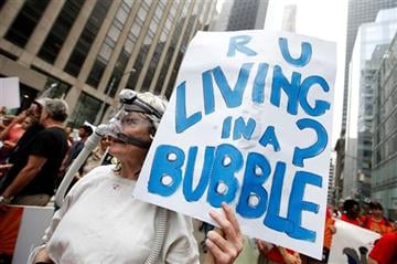 (AP Photo/Jason DeCrow, File). FILE - In this Sept. 21, 2014 file photo, demonstrators make their way down Sixth Avenue in New York during the People's Climate March.