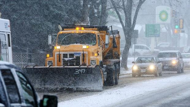 snow plow heads heads down a street Friday, Nov. 20, 2015 in Sioux Falls, S.D. Morning commuters dealt with slick roads as the first significant snowstorm of the season began developing over parts of the Midwest. Widespread amounts of 4 to 8 inches of sn