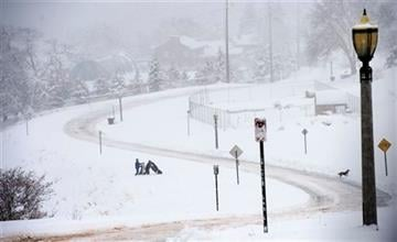 (Steve Griffin/The Salt Lake Tribune via AP). Youngsters head for the hills to sled in Salt Lake City as a major storm dumped snow through out the state, Monday, Dec. 14, 2015. LOCAL STATIONS OUT; MAGS OUT; DESERET NEWS OUT; MANDATORY CREDIT