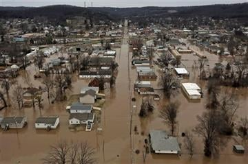 (J.B. Forbes /St. Louis Post-Dispatch via AP). This photo shows a northern view of 1st Street where homes were flooded on Tuesday, Dec. 29, 2015, in Pacific, Mo.