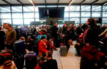 (AP Photo/Sang Tan). Passengers wait underneath blank departure screens following a power outage at the North Terminal of London Gatwick Airport in Horley, England, Tuesday, Dec. 24, 2013.